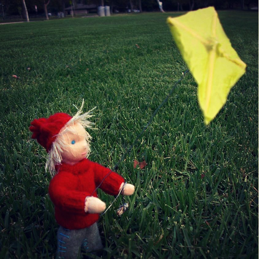 130925 Windswept hair, red lambswool sweater, yellow kite blonde handmade Nova Scotia Kite boy Fall Autumn Waldorf Seasons Nature Table square cropped.