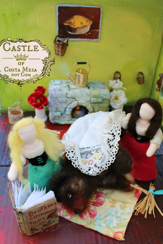 111104 Snow White and Rose Red sisters reading and tuck in grizzly bear with doily in warm hearth 2