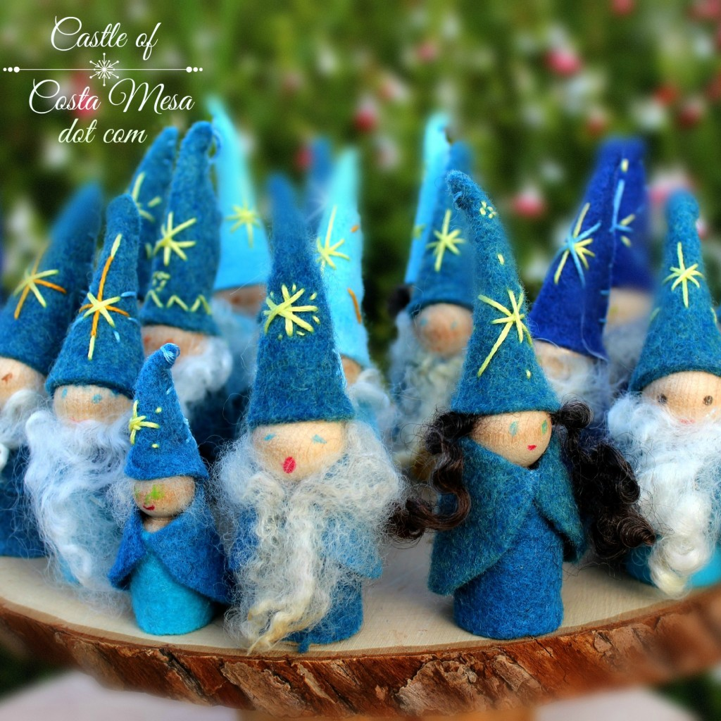 131121 Winter Gnomes Peg Dolls singing with joy in front of Cathy's butterfly bushes square cropped with logo