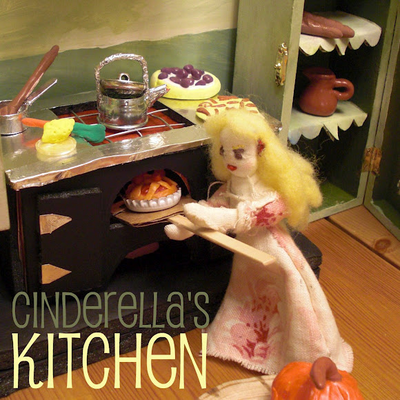 Cinderella's Kitchen. Square. Handmade miniature Cinderella doll and doll house from Cardboard box and other recyclables. Waldorf Fairy Tales dolls and puppet theater for children. CastleofCostaMesa.Com