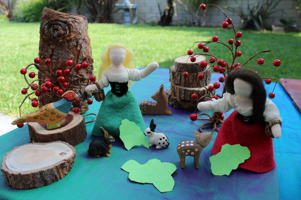 Snow White and Rose Red gathering berries. Handmade and homespun puppet theatre by CastleofCostaMesa.com