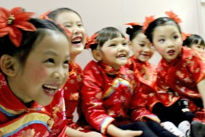 cropped Laughing. Our 10 Gorgeous Traditional Chinese New Year Hexinnian Greeter children dancers in the hallway at Barclay Theatre bac