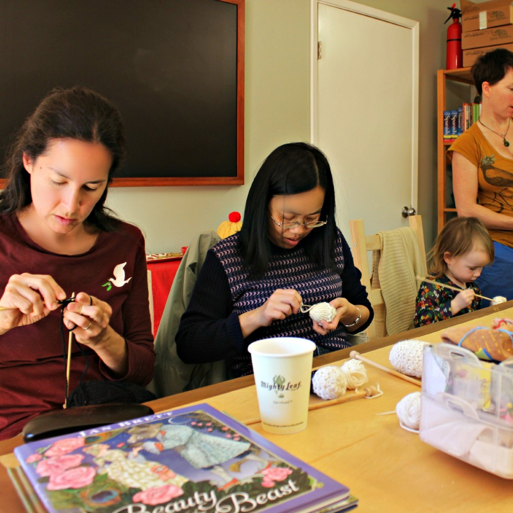 130116 Knitters of all sizes rapt at work. square