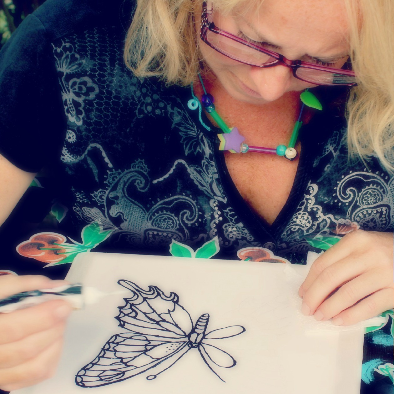 130910 square. Denise painting a swallowtail butterfly on silk using black Gutta resist
