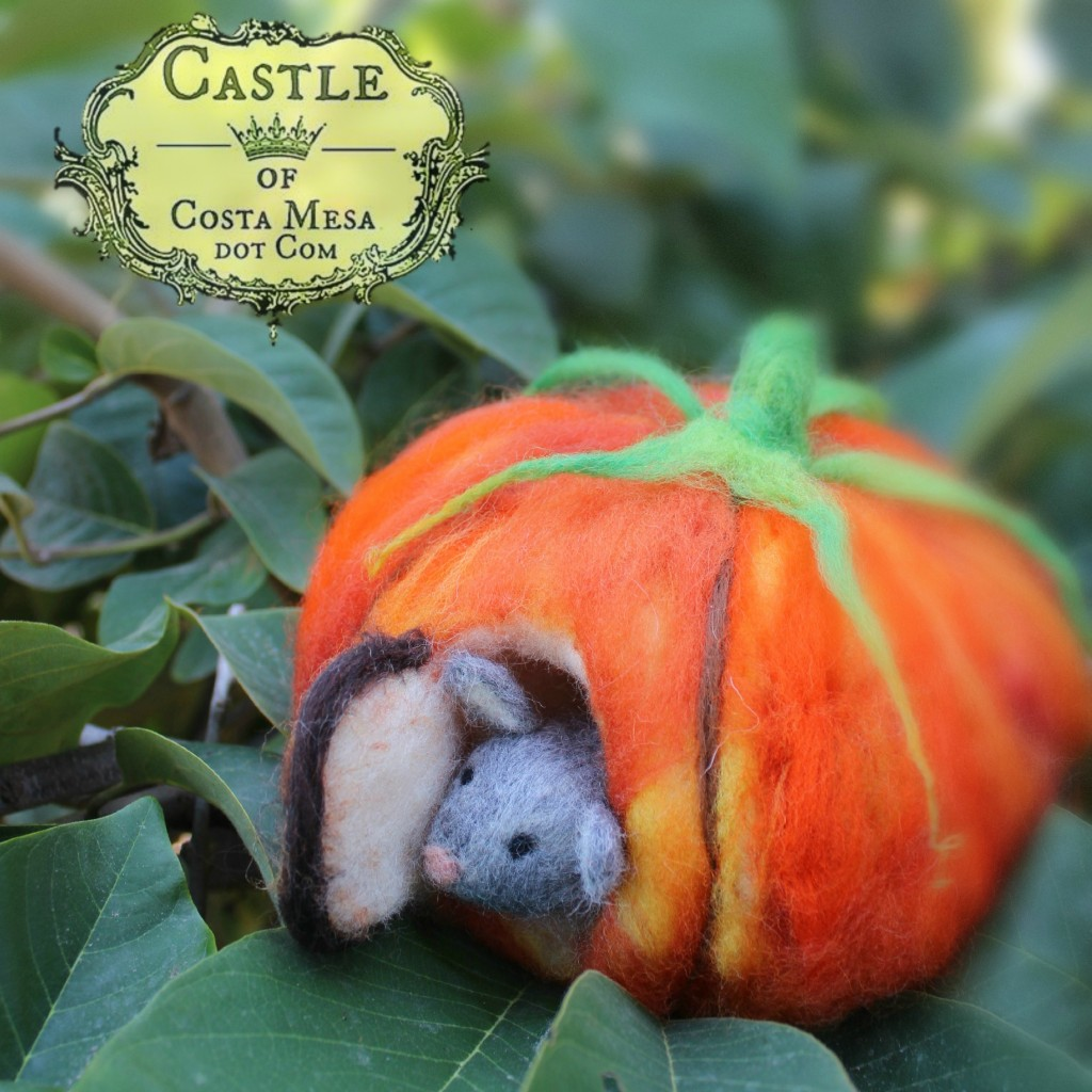 131015 Josephine's needle-felted mouse peering out the door of his orange pumpkin house front door on foggy morning square logo
