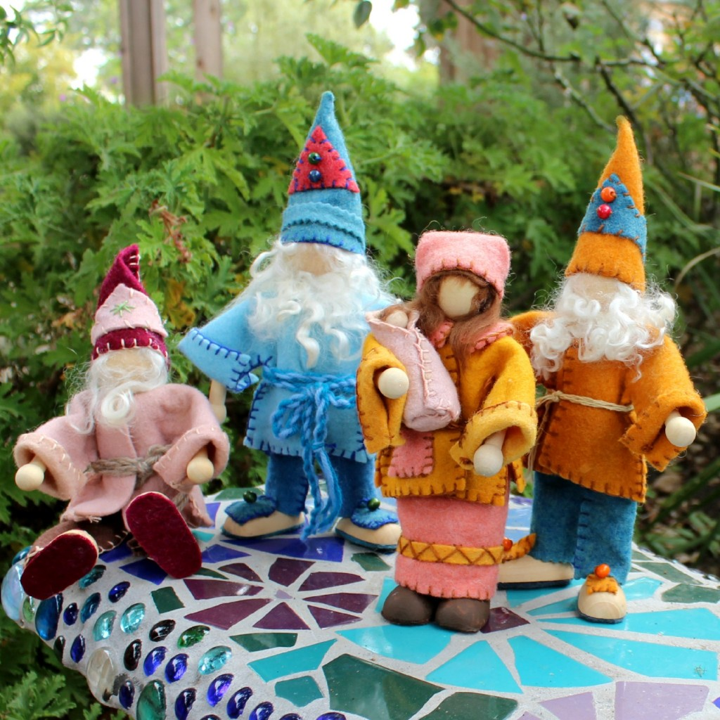 131112 Posable, bendable, wood and wire framed gnome dolls on Rachel Skelly's mosaic bench, square cropped