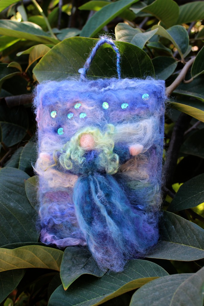 Cathrine's needle-felted guardian angel masterpiece, finished. With stitched loose iridescent sequins. needle felted painting Christmas tree ornament. Costa Mesa Wednesday Morning Waldorf craft group. Steiner Waldorf School of Orange County. CastleofCostaMesa.Com