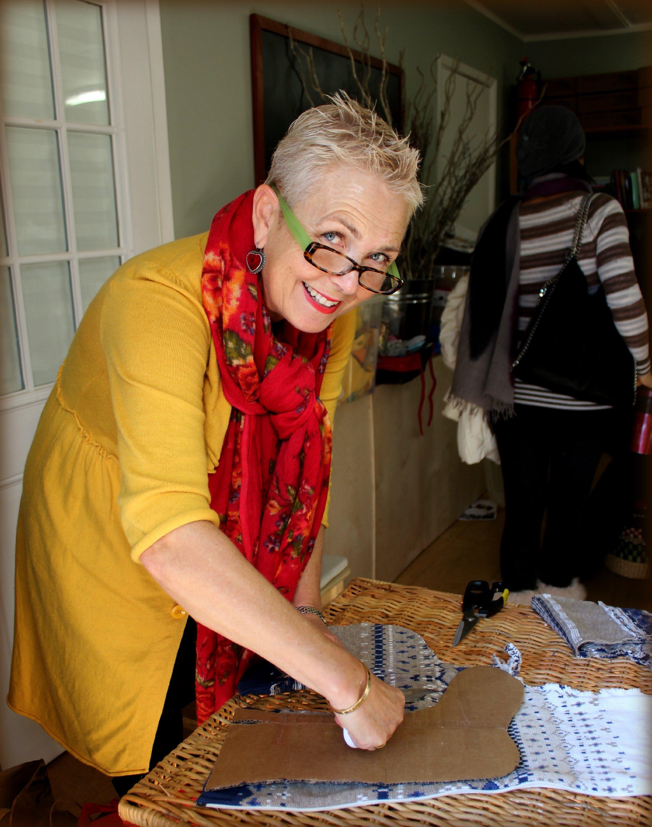 121219 Rachel cutting wool off a stocking template