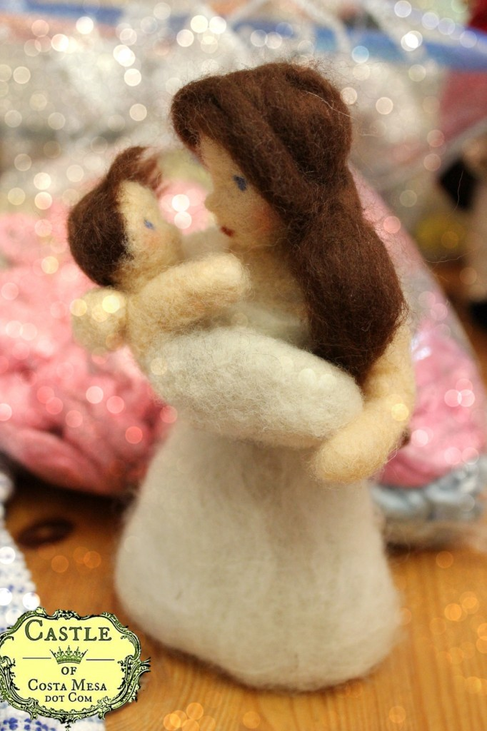 130418 Mother gazing lovingly at her babe in arms. Needle-felted woman in white with baby.