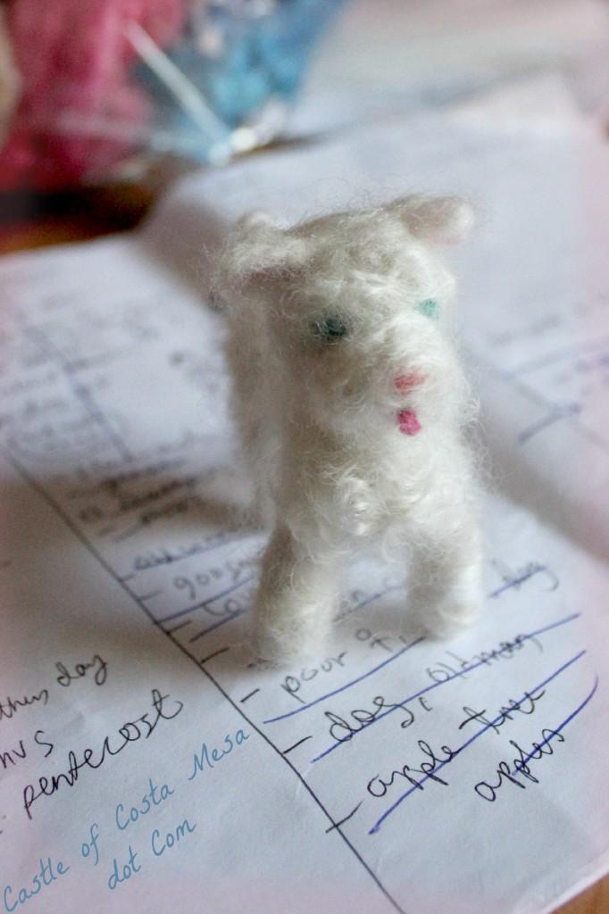 130419 Little White dog on paper logo