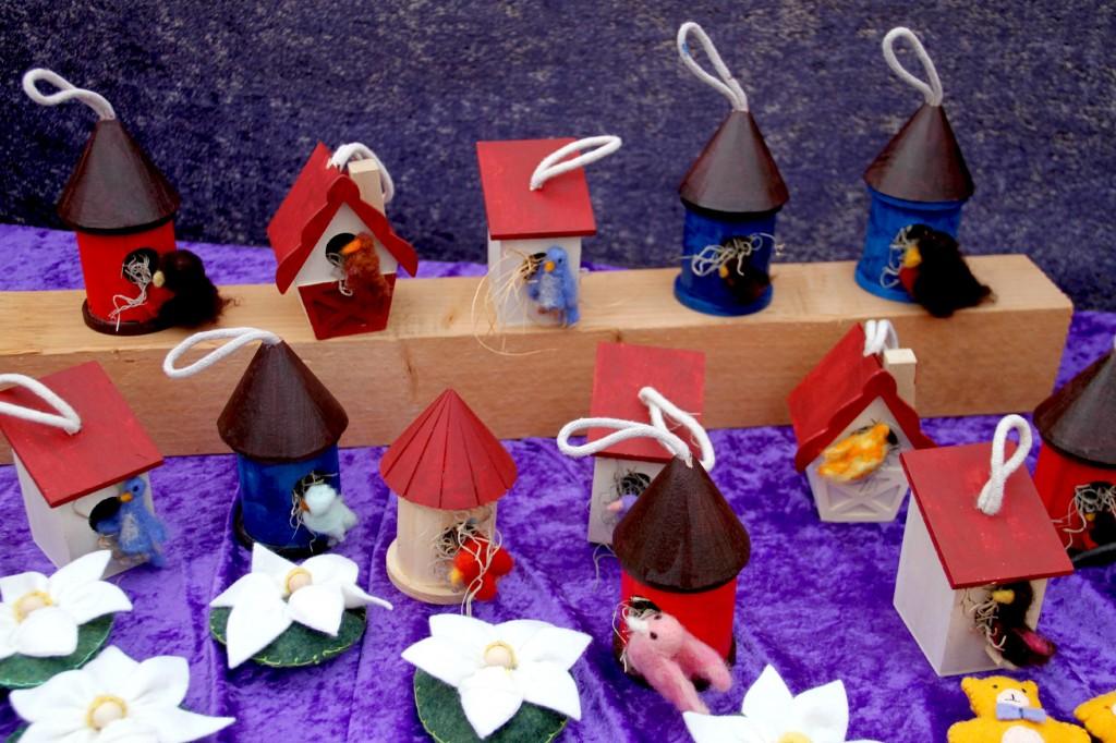 Felted birds in wooden birdhouses