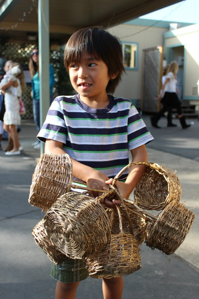 Little boy with elves workshop baskets