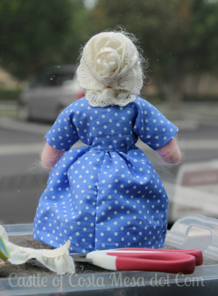 The Old Lady miniature doll back view. Bonnet and bun
