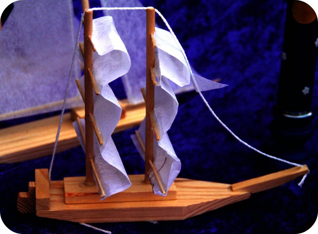 double masted wooden sailboat with white sails