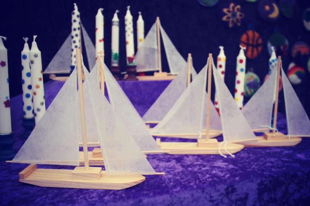 wooden sailboats and beeswax decorated candles