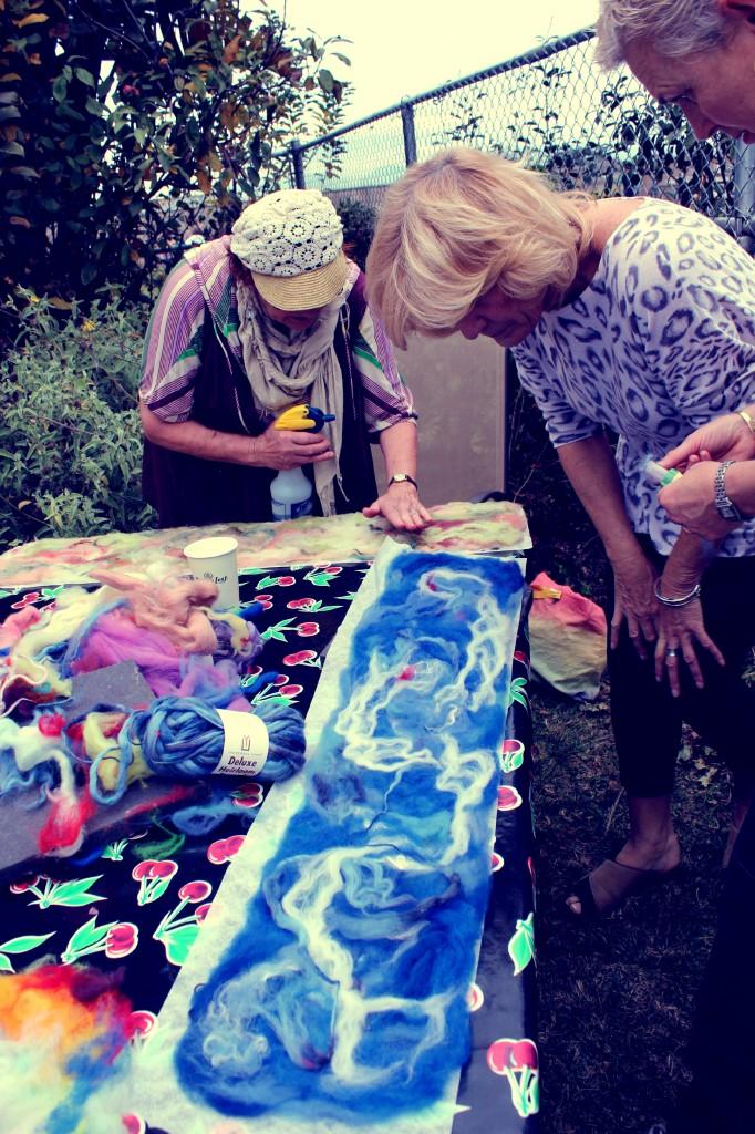 130123 Christine examining Rachel's blue Artfelt scarf project  2