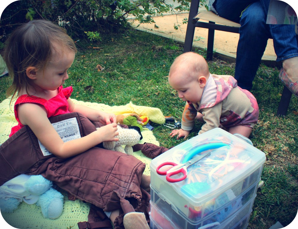 130123 Lucy and Gus playing on a blanket at craft group 3