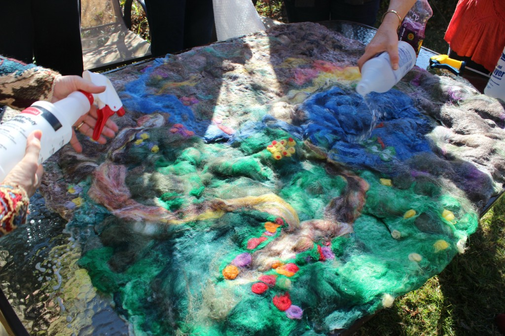 130130 Adding hot water and soap to wet felt our playscape blanket
