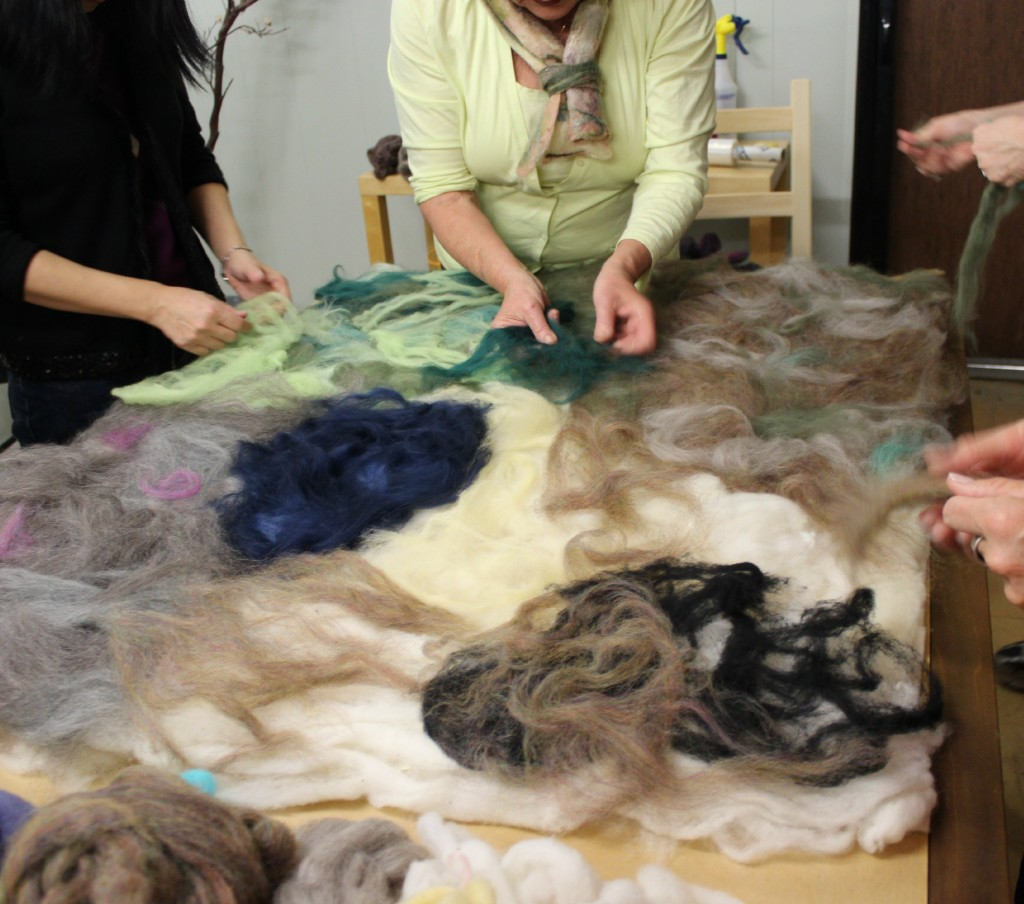 130130 sketching out wet felted playscape with thin layers of colorful roving