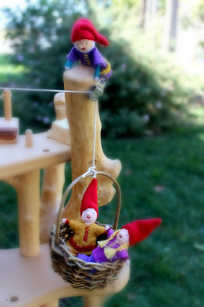 130226 Baskets of gnome children riding a basket on pulley up a magic fairy tree house 2