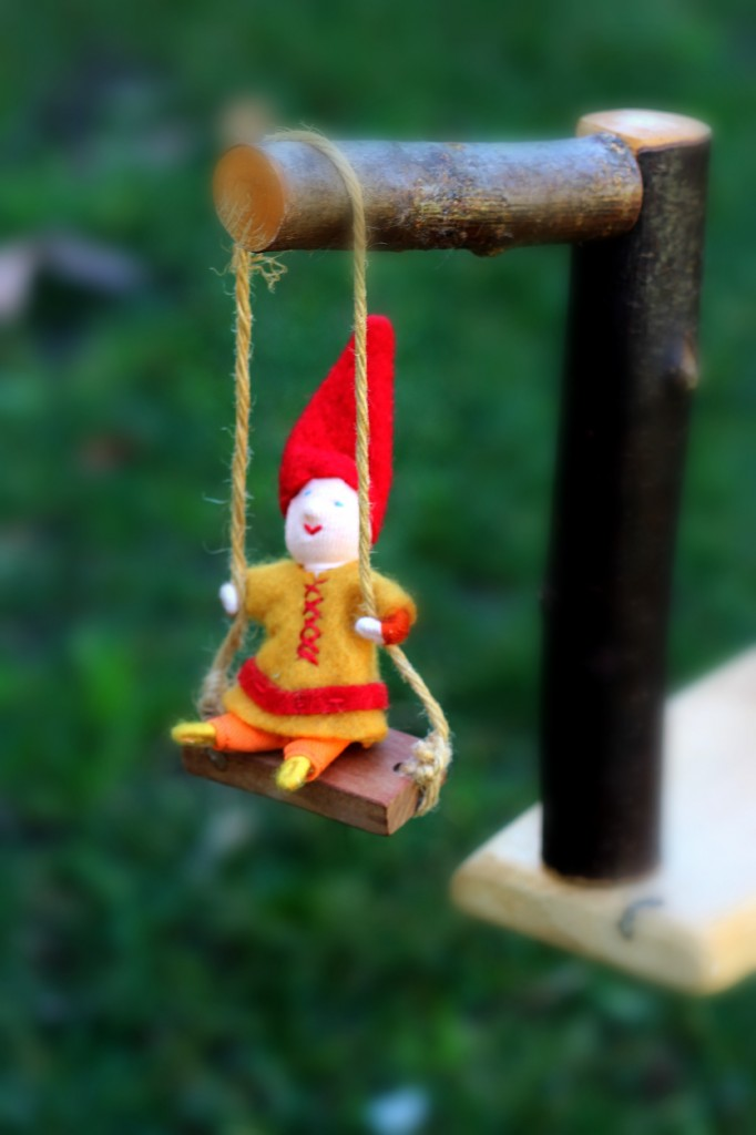 130226 Miniature gnome boy on swing.