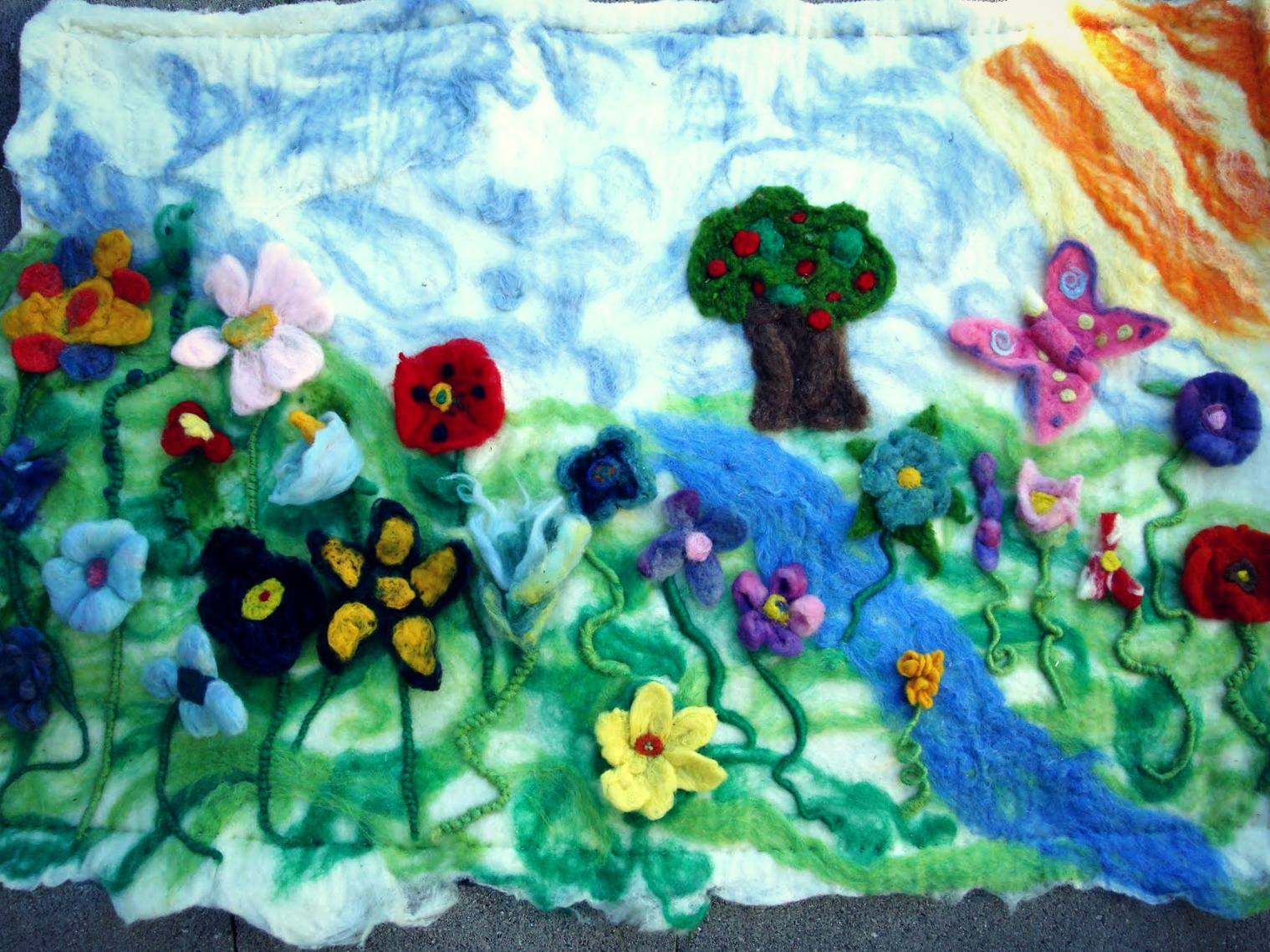 Phaedra Phoenix blog. Textured wet felted mat made by students in Donovan Boy's 5th grade. Adjusted colors