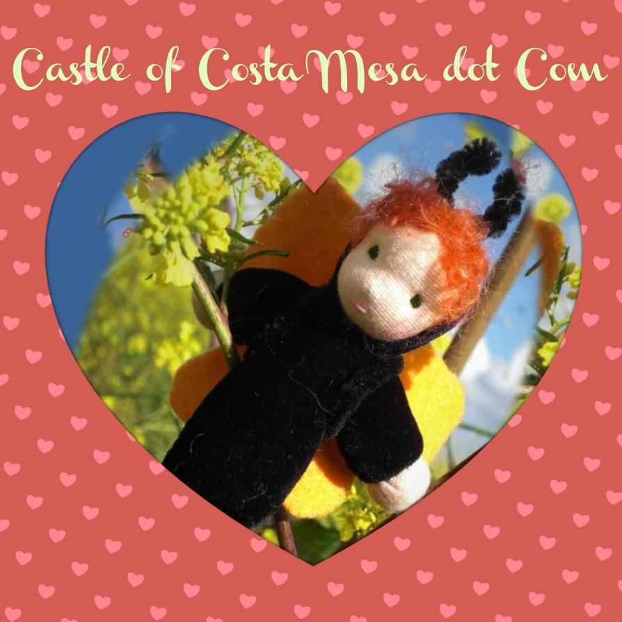 130122 Heart cutout of caterpillar child doll.