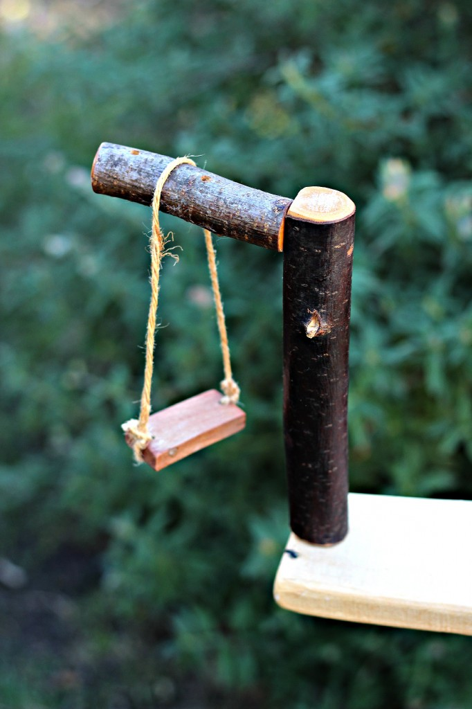 Simple Waldorf wooden miniature swing
