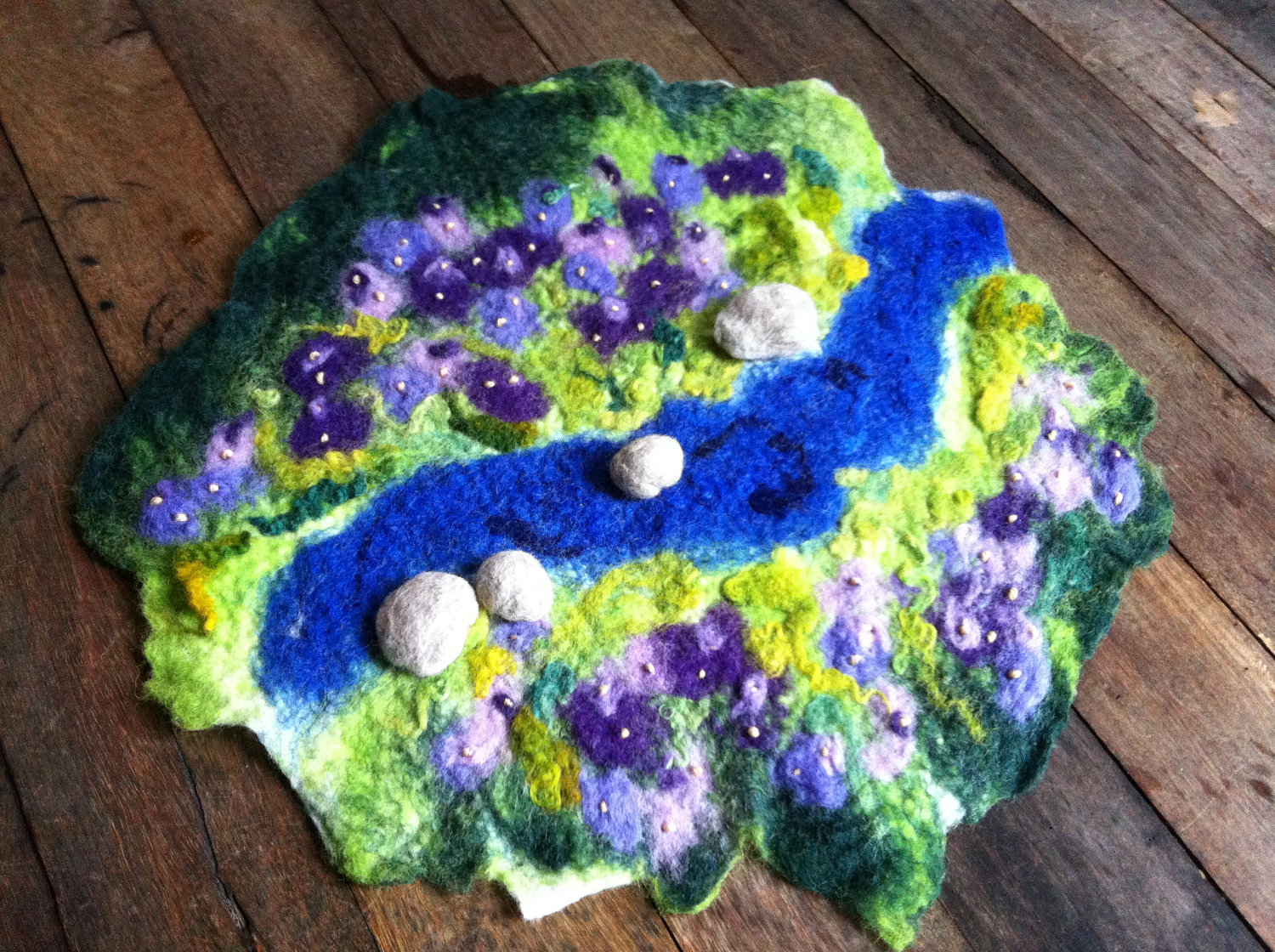 masajesaf on Etsy whole mat. Hand felted Waldorf Steiner Imaginative pretend play story mat wool felt silk nature woods field meadow stream rocks purple flowers