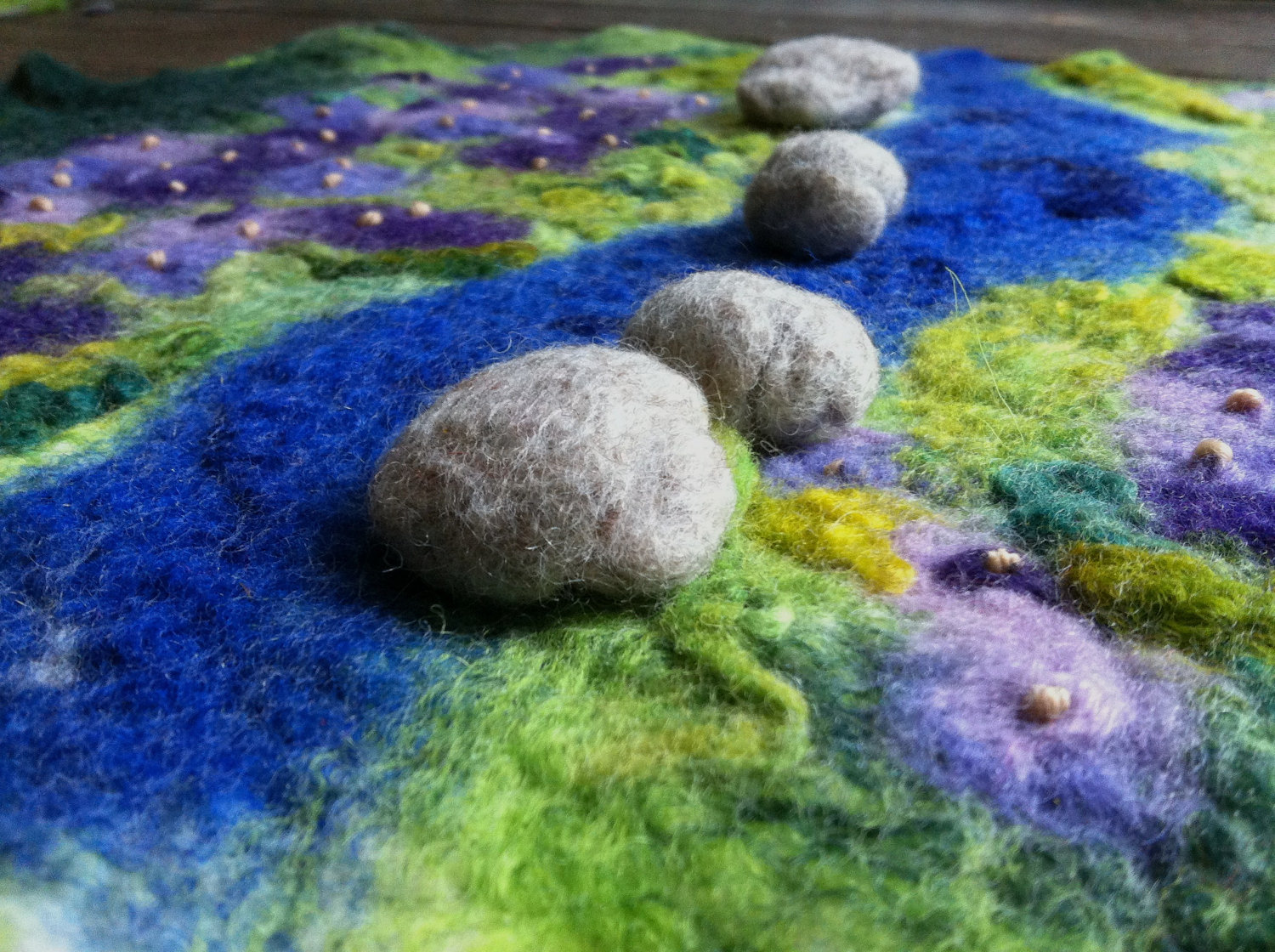 masajesaf on Etsy. Bumpy river rocks by lavendar stream flowers