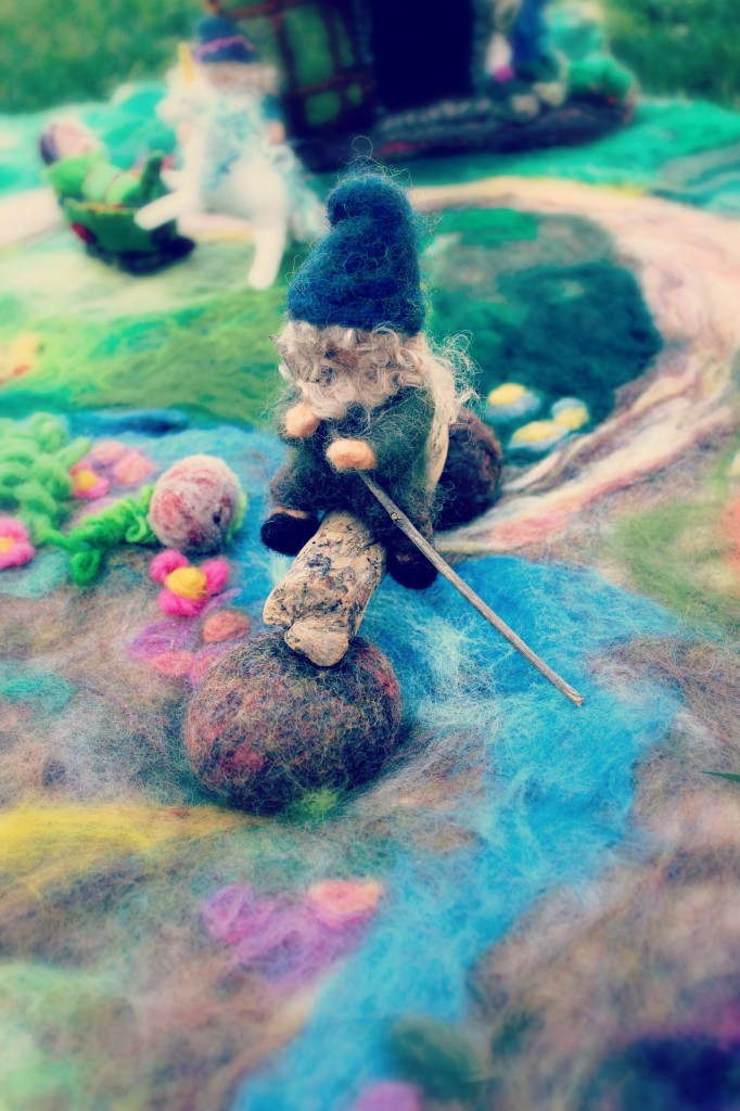 130227 The little needle-felted gnome sitting atop a stream