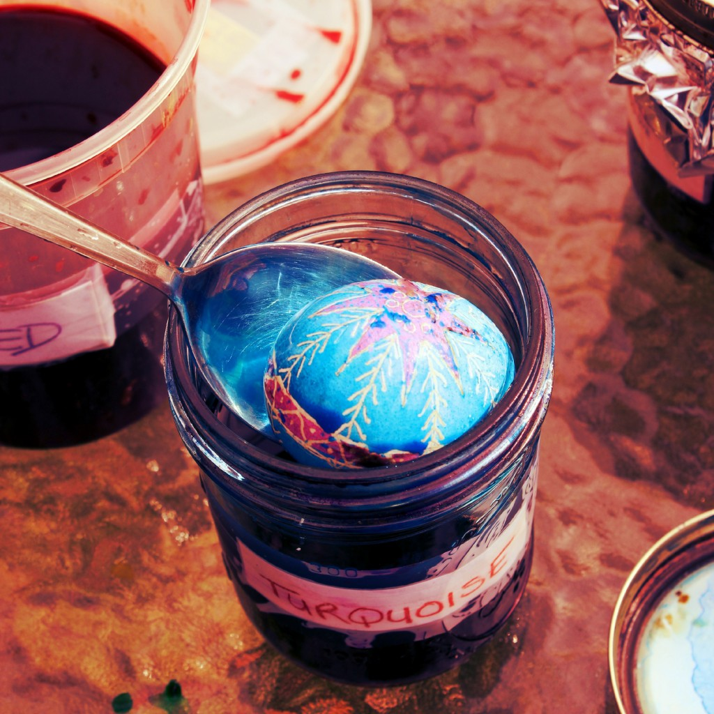 130320 Julia's Ukrainian egg dipped in turqoise dye in jar.