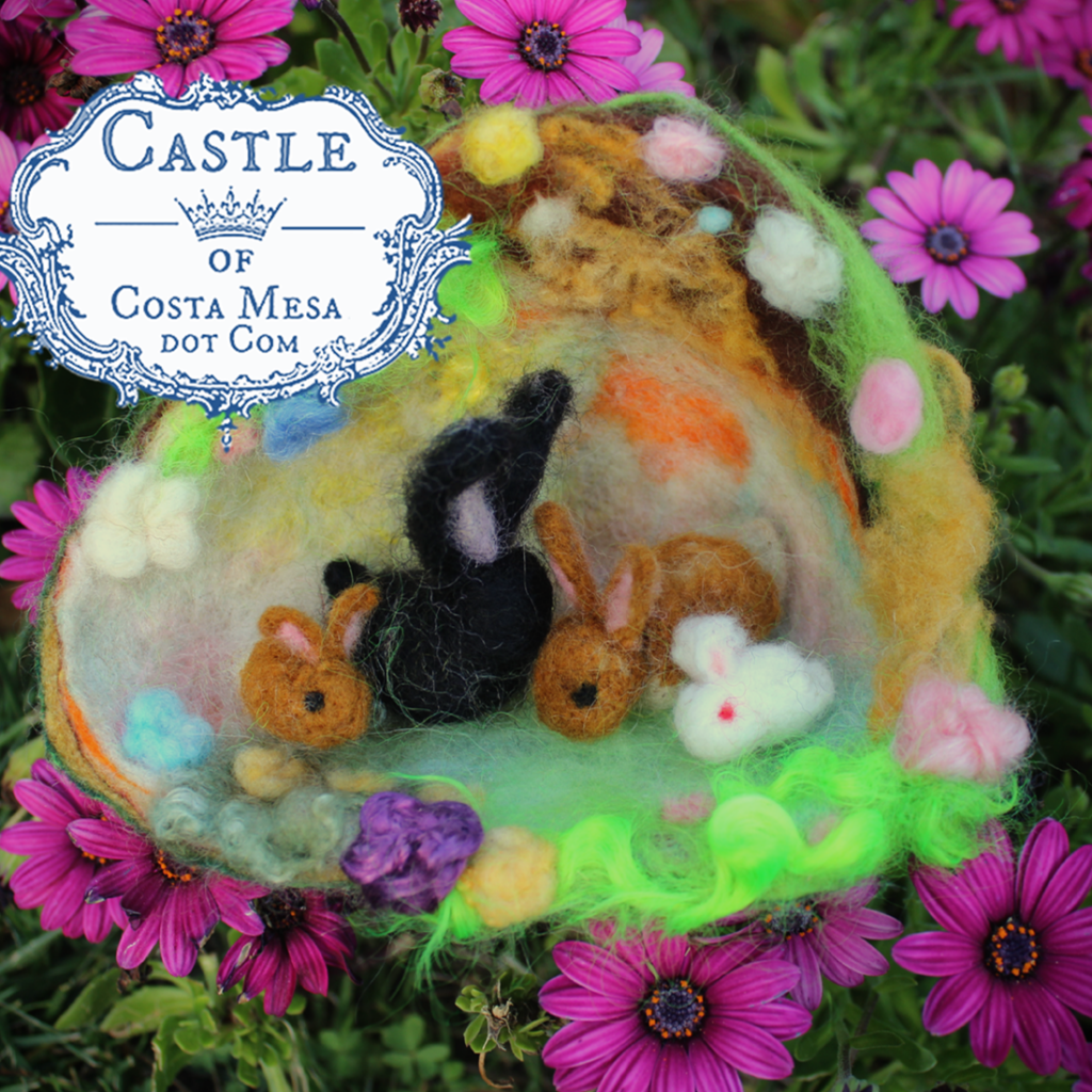 130324 Spring craft. A family of felted rabbits in a burrow. logo