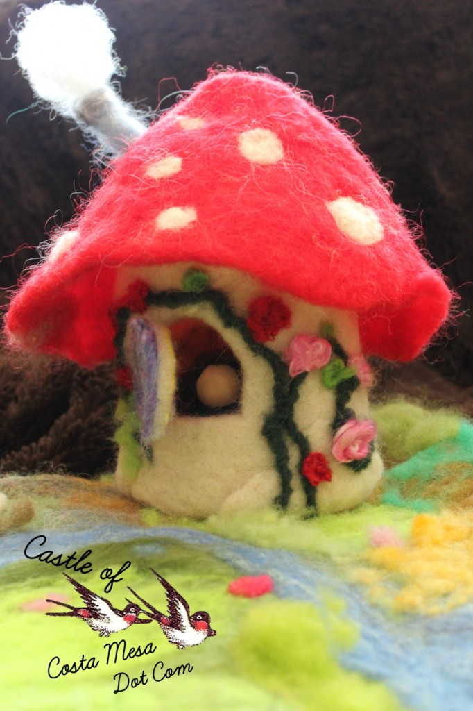 130408 Nunu's toadstool cottage with brunette peg doll. Logo