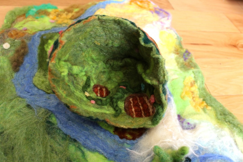 130498 Reversible felted Gnome Home under a hill