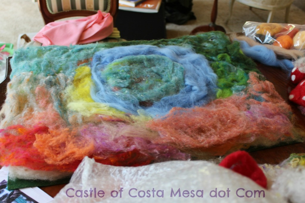 130403 layering colorful PeaceFleece wool roving on playscape landscape blanket