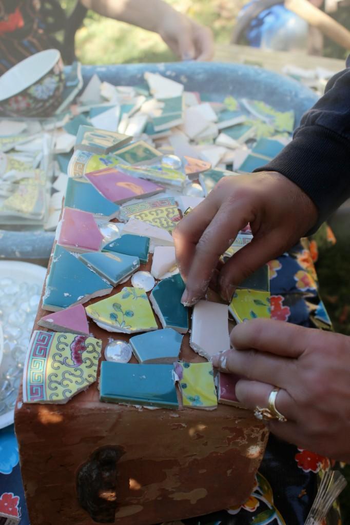 130410 Gaby arranging tile on fairy garden planter for her first grader