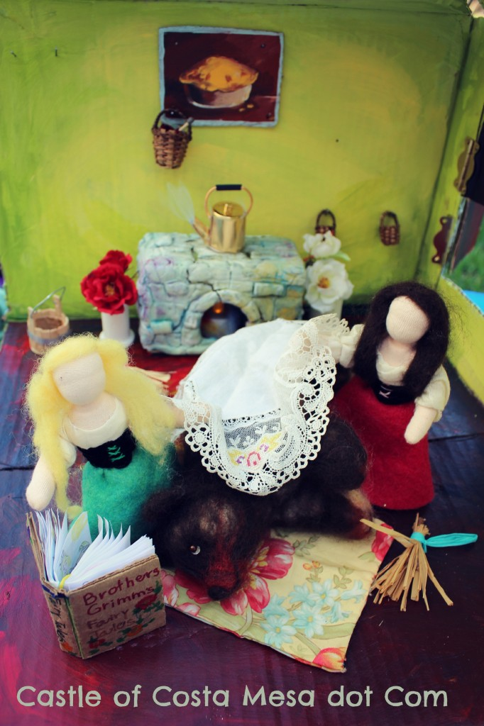130428 Sisters with bear and doily in kitchen with logo