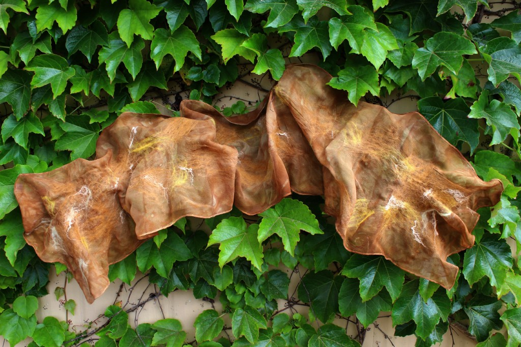 130501 Christine's brown Nuno-felted scarf on Company of Angels ivy wall