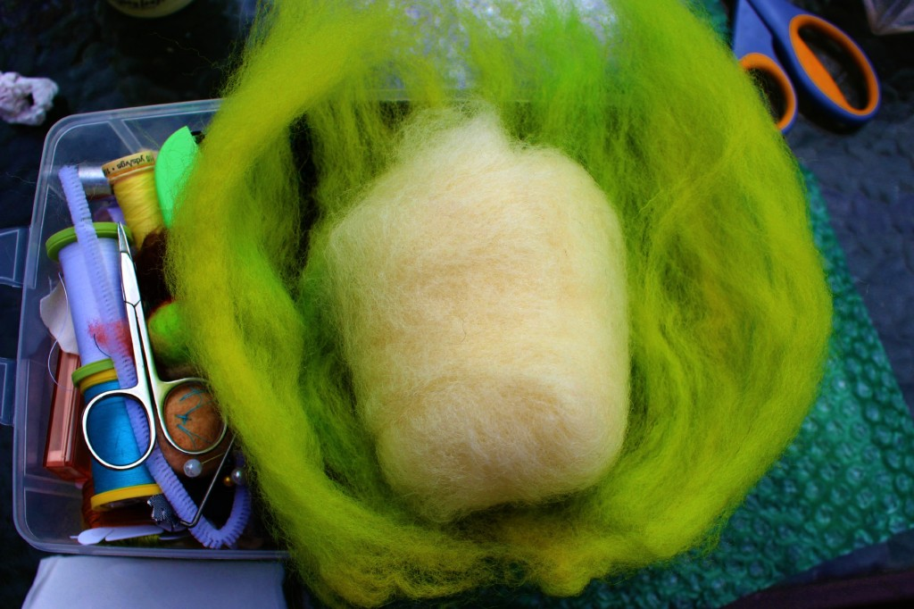 130501 Jzin's wet-felted soap white batting wrapped in chartreuse colored wool roving on Jzin's craft box