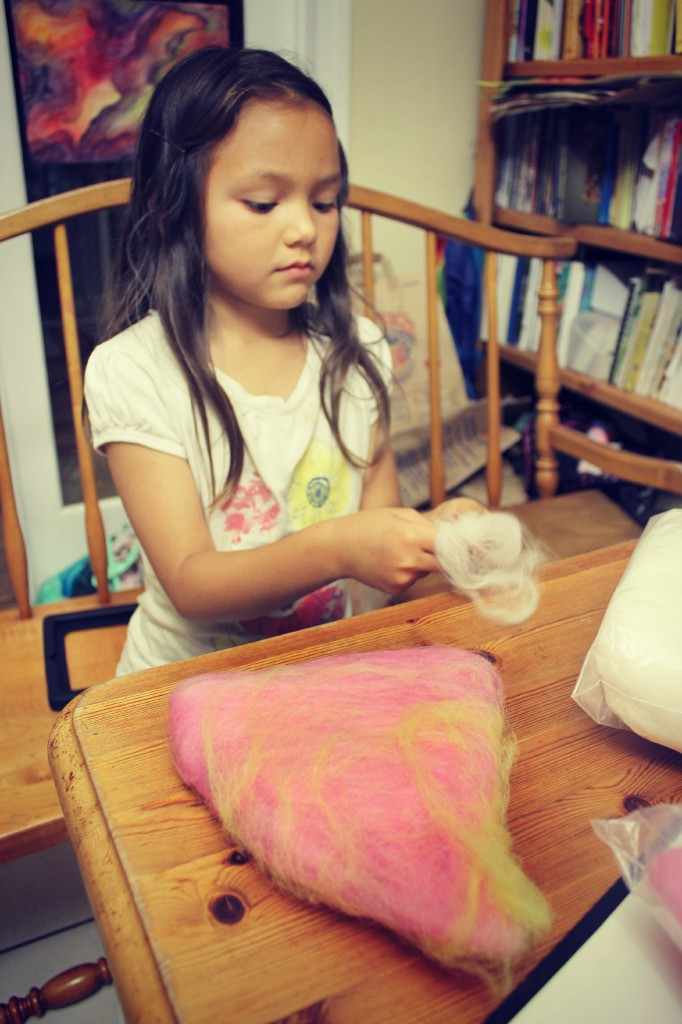 130519 Nunu laying thin layers of wool tops onto baby flower fairy hat for wet-felting