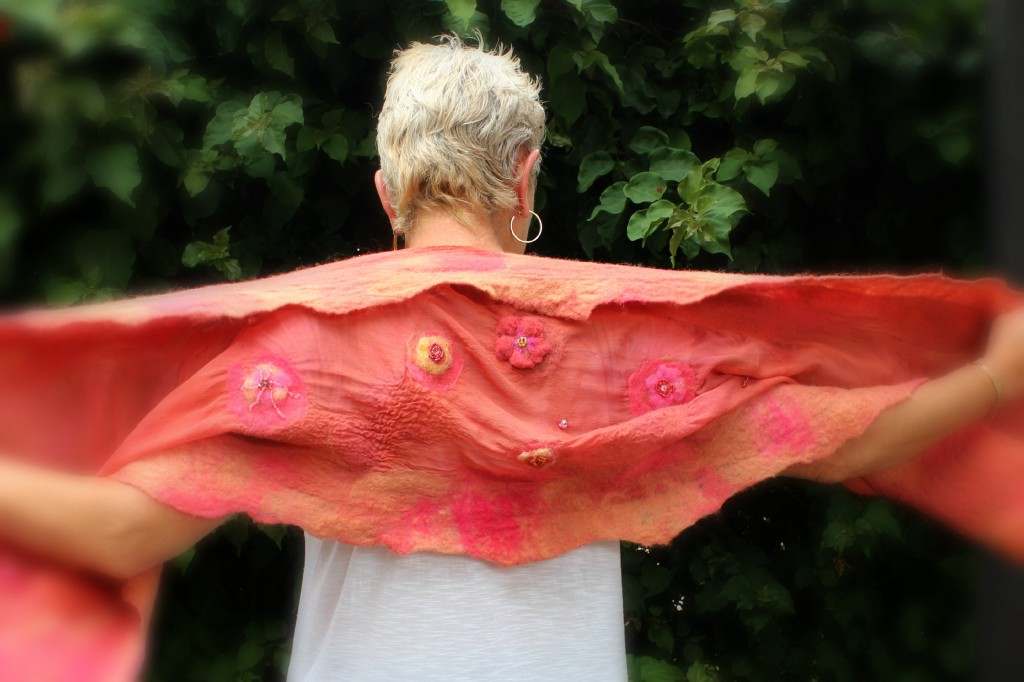 130605 Rachel Skelly back view modelling Gisela's nuno felted salmon red orange silk scarf beaded