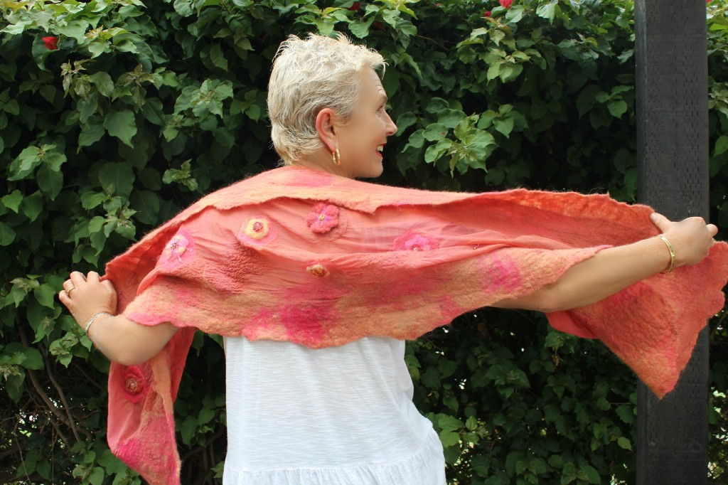 130605 Rachel Skelly modeling Gisela's nuno felted salmon colored silk beaded scarf back view