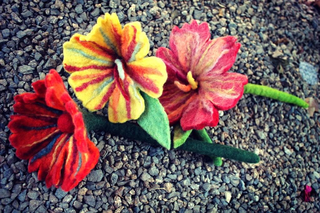 130529 Rachel's 3 wet felted flowers with stems on gravel