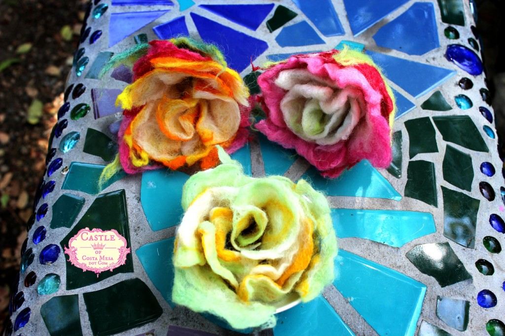 130530 3 newly finished crafted wet-felted roses on Rachel Skelly's mosaic bench