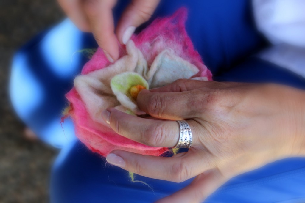 130530 close up view Christine folding petals of wet-felted flower to form rosette swirl of a rose