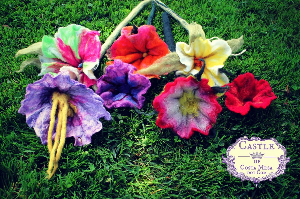 130605 7 completed wet-felted flowers with long stems from this morning's wet-felting work with logo