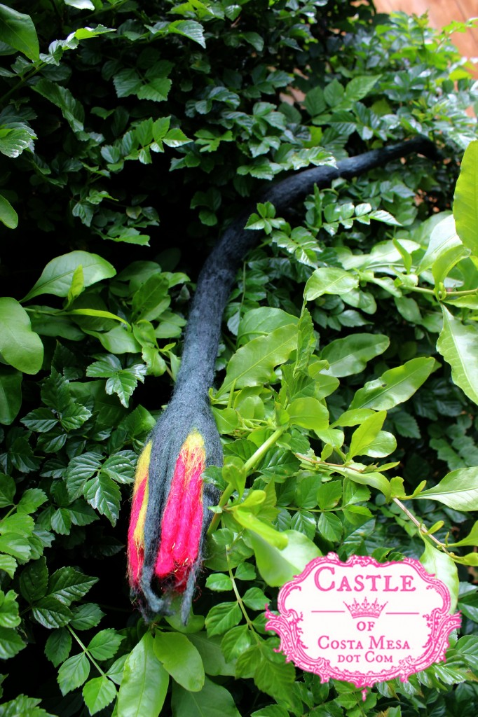 130605 Jzin's newly wet-felted trumpet shaped flower with long stem drying on the honeysuckle bush