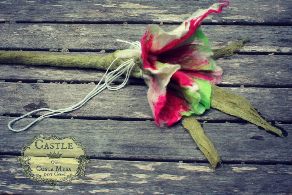 130605 Solana's wet-felted flower with long stem tied up with a string to dry into shape in the sun