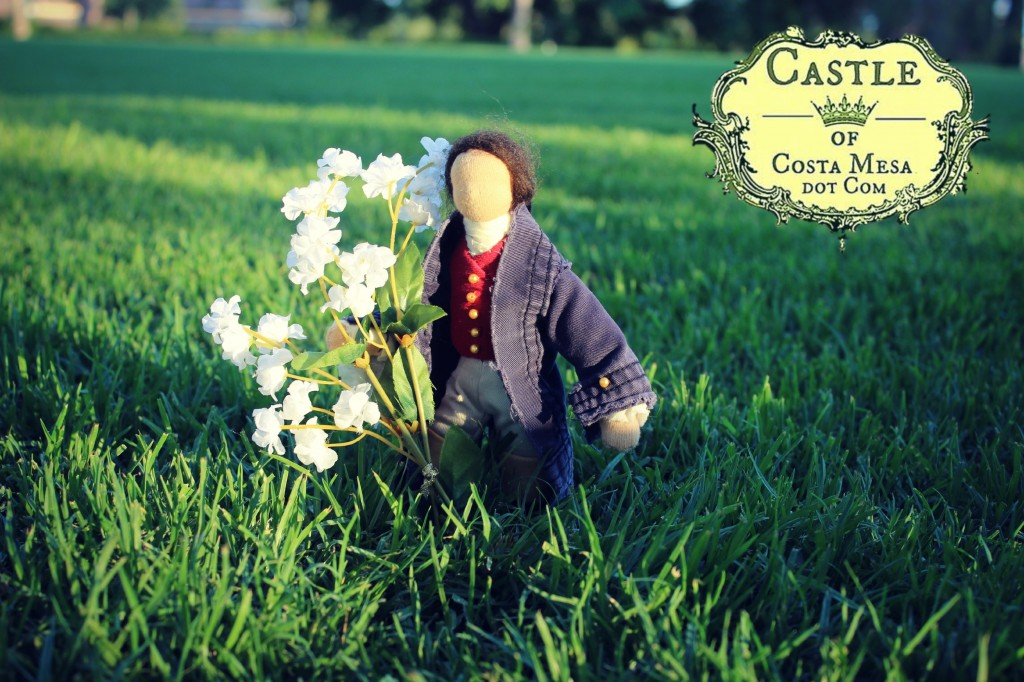 130713 Handsome young man doll with bouquot of white flowers in an open field Balearic